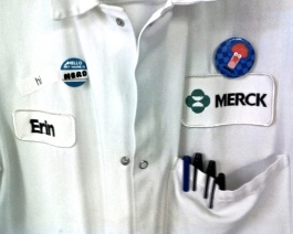 Picture of scientist shirt with a button saying my name is nerd